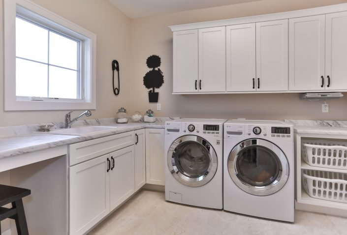 Laundry Room cabinetry with sink under window