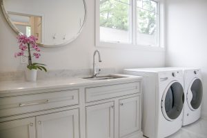 Laundry Room cabinetry with mirror and sink