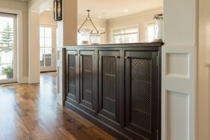 Entertainment area cabinets with mesh inserts