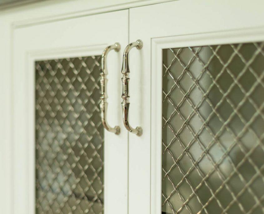Pool House storage cabinet with mesh door