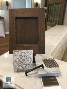 Kitchen & Bath Trend Bronze Metal with Plato cabinet door vingnette with mesh insert and countertop