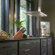 Contemporary kitchen cabinets Plato Woodwork dark finish stainless steel range hood jpg