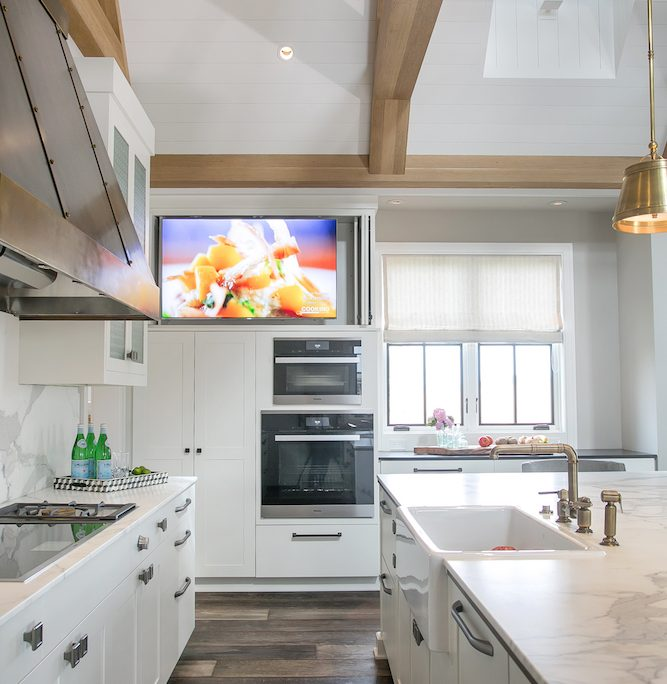 Farmhouse Plato Kitchen Cabinetry cooktop hood quartz beams ovens television built in