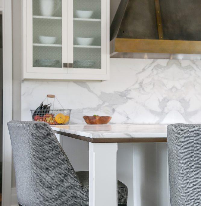 Farmhouse Plato Kitchen Cabinetry Display Range hood black brass island detail