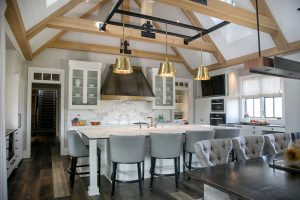 Farmhouse Plato Woodwork Kitchen Cabinetry Island dining display pendant lighting brass black white quartz countertops
