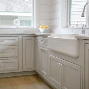 Lake House Kitchen Cabinetry farmhouse apron front sink dishwasher with panel cornercabinet