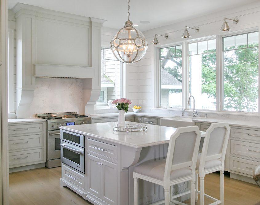 Lake House Kitchen Cabinetry large island windows stove island range hood globe island lighting