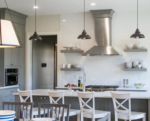 Geneva Cabinet Company Top 2018 Trends for Cabinetry modern farmhouse kitchen with open concept shelving and stainless range hood
