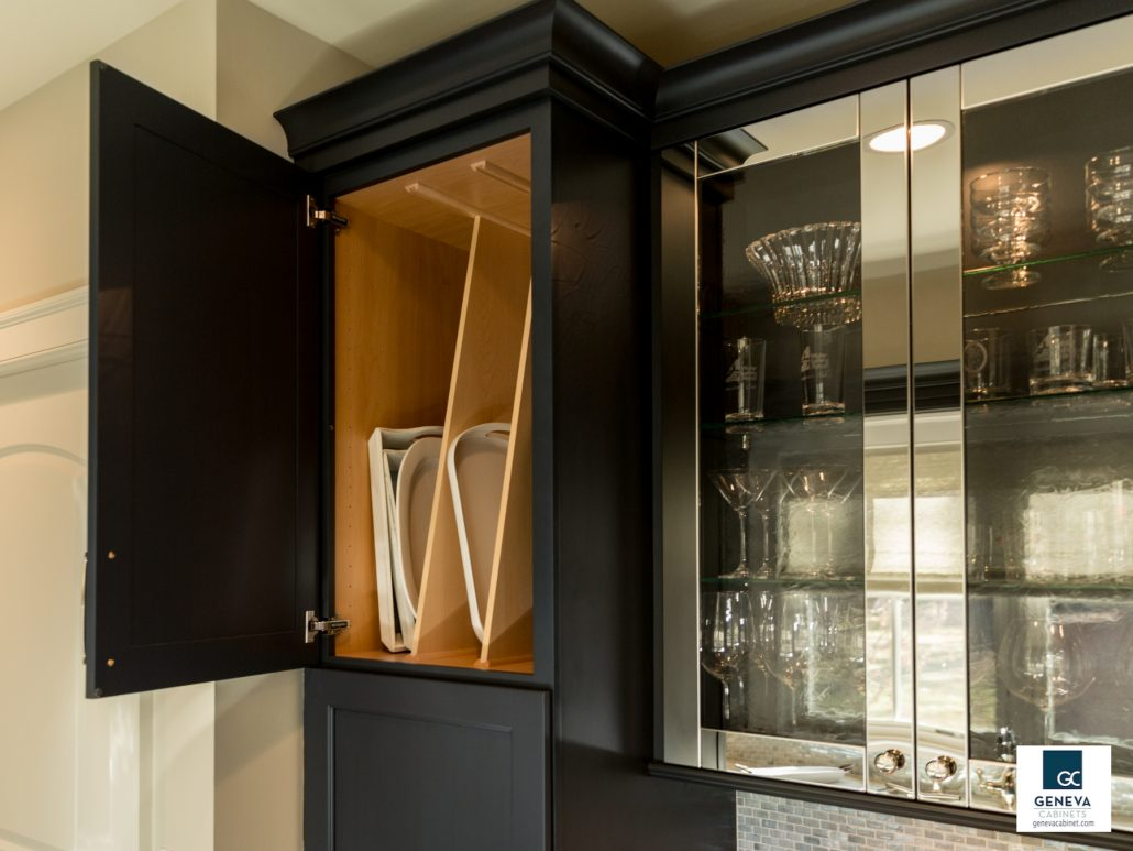 iday kitchen preparations serving trays ready glasses cleaned Black cabinetry with metallic door in gloss metal