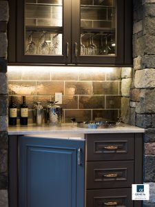 holiday kitchen preparations beverage bar cabinetry WoodMode cabinetry bar cabinet and serving storage with mini under counter refrigerator