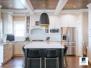 Geneva Cabinet Company kitchen with new island Plato Cabinetry