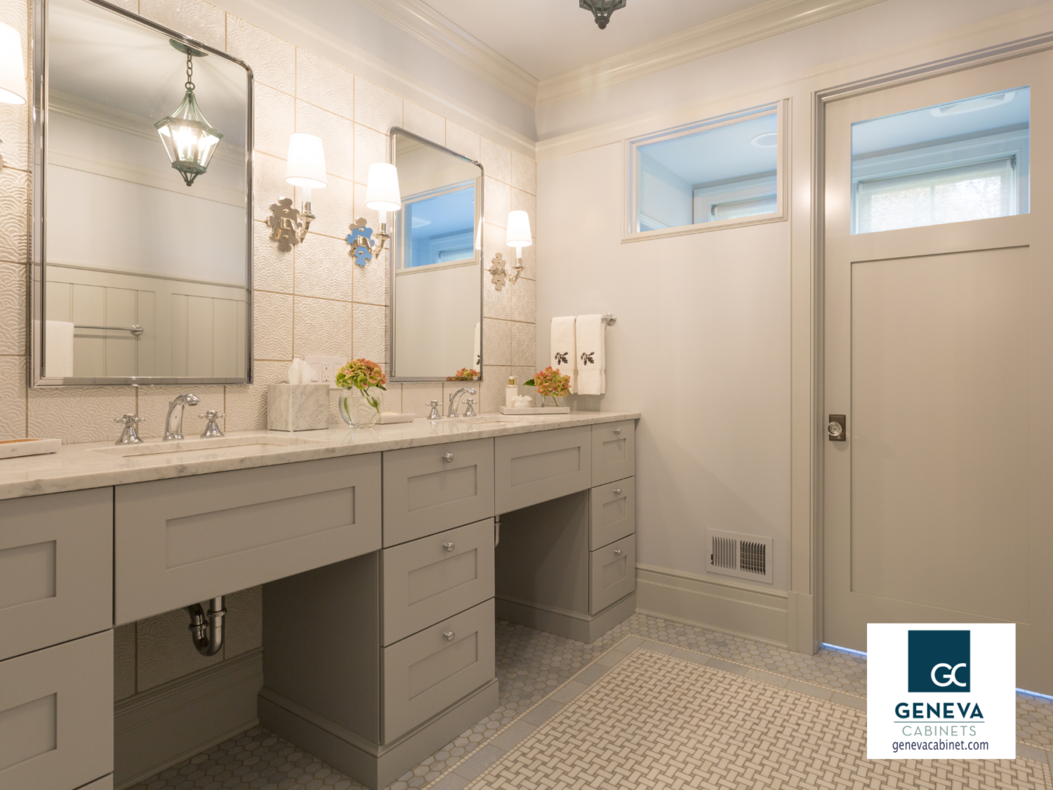 Neutral bathroom cabinet with interesting textured tile surround